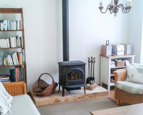 Sitting room with woodburning stove at Village House